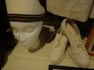 The hat and shoes of a WWII nurse.